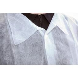 Blouse jetable blanche avec fermeture pressions et poignets élastiqués T.L